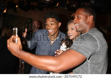 LOS ANGELES - AUG 14:  Rome Flynn, Reign Edwards, Lawrence Saint-Victor_ at the Bold and Beautiful Fan Event Friday at the CBS Television City on August 14, 2015 in Los Angeles, CA - stock photo