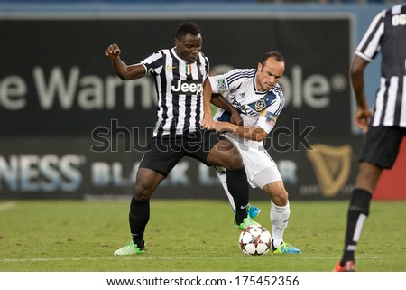 LOS ANGELES - AUGUST 3: Galaxy M Landon Donovan & Juventus M Kwadwo Asamoah during the 2013 GICC game between Juventus & the Los Angeles Galaxy on Aug 3, 2013 at Dodger Stadium. - stock photo