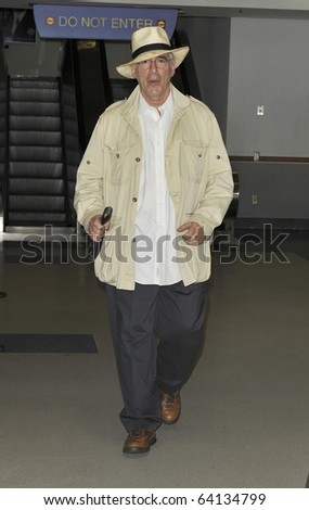 LOS ANGELES - AUGUST 4TH: Actor Elliott Gould is seen at LAX . August 4th 2010 in Los Angeles, California
