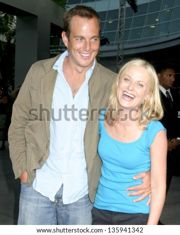"""LOS ANGELES - AUGUST 11: Will Arnett,  Amy Poehler arriving at the """"40 Year Old Virgin"""" Premiere at Arc Light Theaters August 11, 2005 in Los Angeles, CA. - stock photo"""