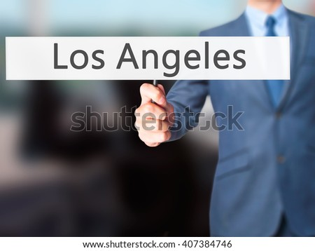 Los Angeles - Businessman hand holding sign. Business, technology, internet concept. Stock Photo - stock photo
