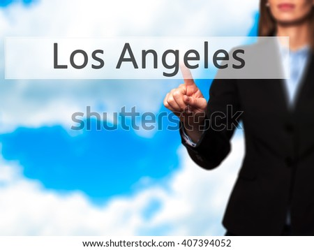 Los Angeles - Businesswoman hand pressing button on touch screen interface. Business, technology, internet concept. Stock Photo - stock photo