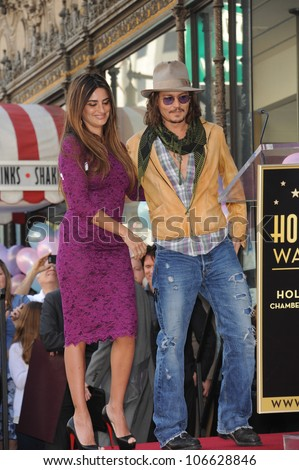 LOS ANGELES, CA - APRIL 1, 2011: Actress Penelope Cruz & actor Johnny Depp on Hollywood Boulevard where she was honored with a star on the Hollywood Walk of Fame. April 1, 2011  Los Angeles, CA - stock photo
