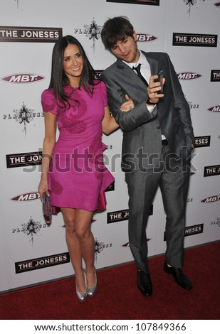 "LOS ANGELES, CA - APRIL 8, 2010: Demi Moore & Ashton Kutcher at the Los Angeles premiere of her new movie ""The Joneses"" at the Arclight Theatre, Hollywood. - stock photo"