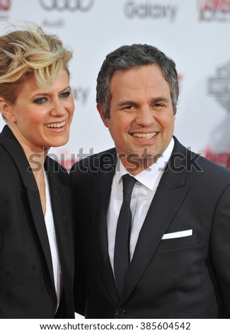 """LOS ANGELES, CA - APRIL 13, 2015: Mark Ruffalo & wife Sunrise Coigney at the world premiere of his movie """"Avengers: Age of Ultron"""" at the Dolby Theatre, Hollywood. - stock photo"""