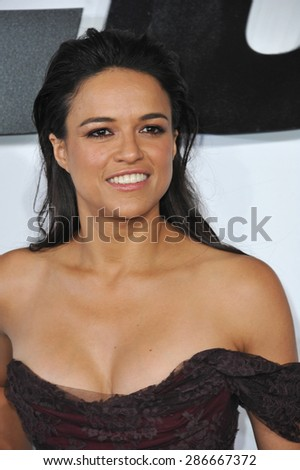 "LOS ANGELES, CA - APRIL 1, 2015: Michelle Rodriguez at the world premiere of her movie ""Furious 7"" at the TCL Chinese Theatre, Hollywood.  - stock photo"