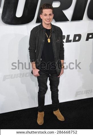 "LOS ANGELES, CA - APRIL 1, 2015: Musician Charlie Puth at the world premiere of ""Furious 7"" at the TCL Chinese Theatre, Hollywood.  - stock photo"