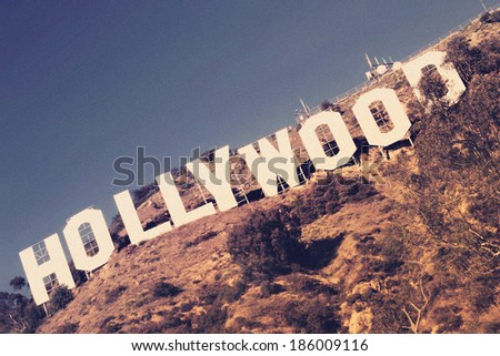 LOS ANGELES, CA - APRIL 3, 2014: The famous Hollywood Sign in a diagonal composition with vintage toning and authentic film grain - stock photo