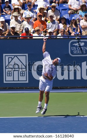 Los Angeles CA, Aug. 10 2008: Andy Roddick hitting a serve at the championship match of the Countrywide Classic tennis tournament in Los Angeles on Aug.10 2008 - stock photo