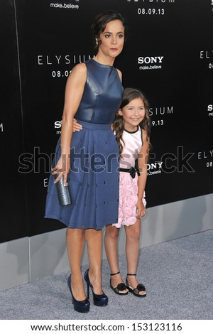 "LOS ANGELES, CA - AUGUST 7, 2013: Alice Braga & Emma Tremblay (right) at the world premiere of their movie ""Elysium"" at the Regency Village Theatre, Westwood.  - stock photo"