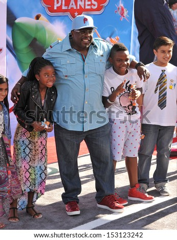 LOS ANGELES, CA - AUGUST 5, 2013: Cedric the Entertainer & family at the world premiere of his movie Disney's Planes at the El Capitan Theatre, Hollywood.