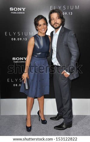 "LOS ANGELES, CA - AUGUST 7, 2013: Diego Luna & Alice Braga at the world premiere of their movie ""Elysium"" at the Regency Village Theatre, Westwood.  - stock photo"