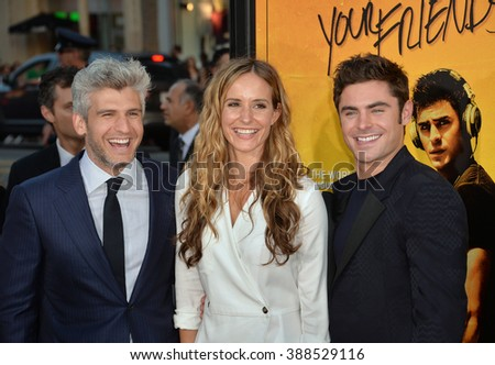 "LOS ANGELES, CA - AUGUST 20, 2015: Director/co-writer Max Joseph (left) & actor Zac Efron with screenwriter Meaghan Oppenheimer at the Los Angeles premiere of their movie ""We Are Your Friends""  - stock photo"