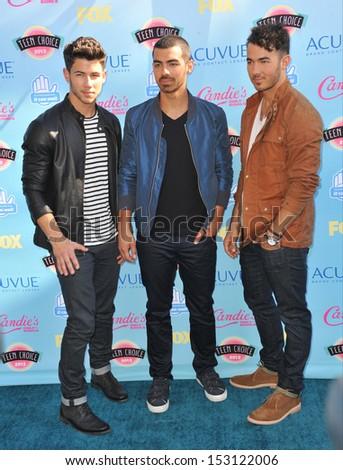LOS ANGELES, CA - AUGUST 11, 2013: Jonas Brothers - Nick Jonas, Kevin Jonas & Joe Jonas - at the 2013 Teen Choice Awards at the Gibson Amphitheatre, Universal City, Hollywood.  - stock photo