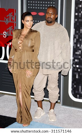 LOS ANGELES, CA - AUGUST 30, 2015: Kanye West and Kim Kardashian at the 2015 MTV Video Music Awards held at the Microsoft Theater in Los Angeles, USA on August 30, 2015. - stock photo