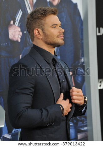 "LOS ANGELES, CA - AUGUST 11, 2014: Kellan Lutz at the Los Angeles premiere of his movie ""The Expendables 3"" at the TCL Chinese Theatre, Hollywood. - stock photo"