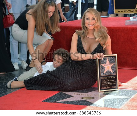 LOS ANGELES, CA - AUGUST 5, 2015: Mariah Carey & son Morocco Cannon on Hollywood Boulevard where she was honored with the 2,556th star on the Hollywood Walk of Fame. - stock photo