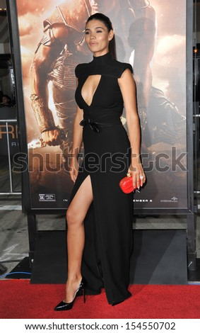 "LOS ANGELES, CA - AUGUST 28, 2013: Model Paloma Jim���½nez at the world premiere of boyfriend Vin Diesel's movie ""Riddick"" at the Regency Village Theatre, Westwood.  - stock photo"