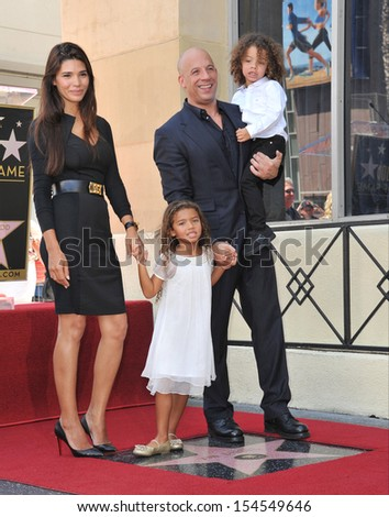 LOS ANGELES, CA - AUGUST 26, 2013: Vin Diesel & family on Hollywood Blvd where he was honored with the 2,504th star on the Hollwood Walk of Fame.
