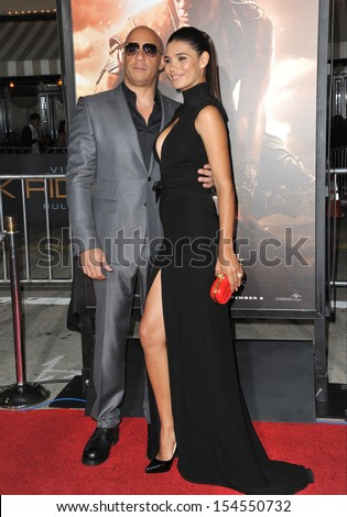 "LOS ANGELES, CA - AUGUST 28, 2013: Vin Diesel & girlfriend Paloma Jimenez at the world premiere of his movie ""Riddick"" at the Regency Village Theatre, Westwood."