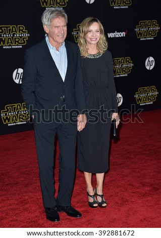 "LOS ANGELES, CA - DECEMBER 14, 2015: Actor Harrison Ford & actress wife Calista Flockhart at the world premiere of ""Star Wars: The Force Awakens"" on Hollywood Boulevard - stock photo"