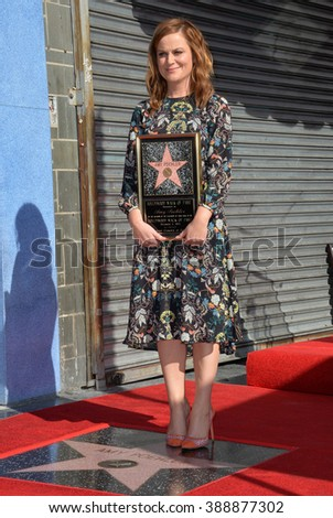 LOS ANGELES, CA - DECEMBER 3, 2015: Actress Amy Poehler on Hollywood Boulevard where she was honored with the 2,566th star on the Hollywood Walk of Fame.  - stock photo