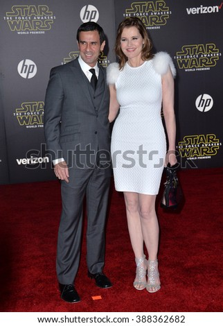 "LOS ANGELES, CA - DECEMBER 14, 2015: Actress Geena Davis & husband Dr. Reza Jarrahy at the world premiere of ""Star Wars: The Force Awakens"" on Hollywood Boulevard - stock photo"