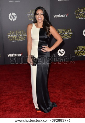 """LOS ANGELES, CA - DECEMBER 14, 2015: Actress Gina Rodriguez at the world premiere of """"Star Wars: The Force Awakens"""" on Hollywood Boulevard - stock photo"""