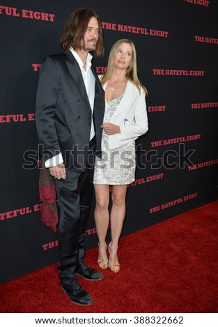 """LOS ANGELES, CA - DECEMBER 7, 2015: Actress Mira Sorvino & husband Christopher Backus at the world premiere of Quentin Tarantino's """"The Hateful Eight"""" at the Cinerama Dome, Hollywood - stock photo"""