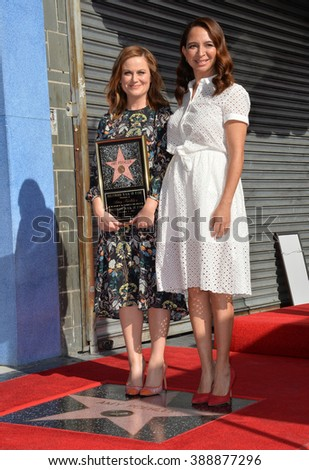 LOS ANGELES, CA - DECEMBER 3, 2015: Actresses Amy Poehler & Maya Rudolph on Hollywood Boulevard where Poehler was honored with the 2,566th star on the Hollywood Walk of Fame.  - stock photo