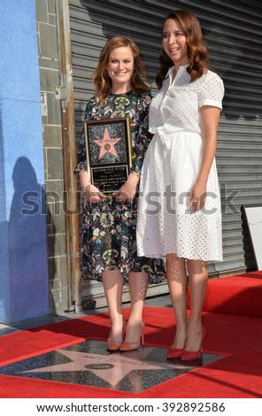 LOS ANGELES, CA - DECEMBER 3, 2015: Actresses Amy Poehler & Maya Rudolph on Hollywood Boulevard where Poehler was honored with the 2,566th star on the Hollywood Walk of Fame - stock photo