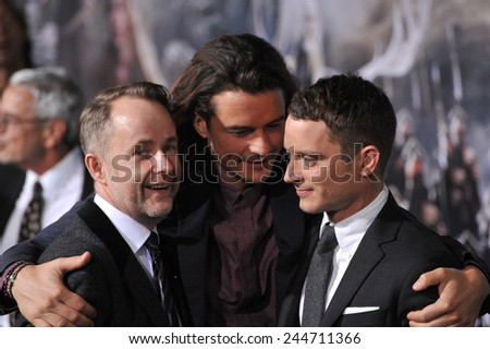 "LOS ANGELES, CA - DECEMBER 9, 2014: Billy Boyd (left), Orlando Bloom & Elijah Wood at the Los Angeles premiere of ""The Hobbit: The Battle of the Five Armies"" at the Dolby Theatre, Hollywood.  - stock photo"