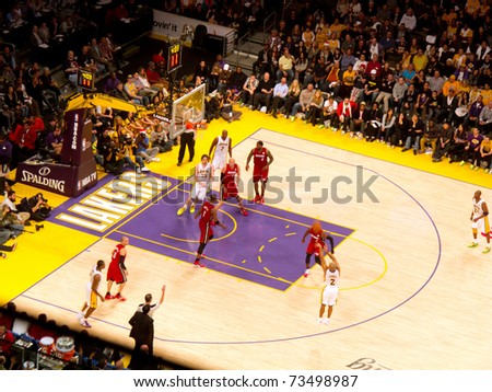 LOS ANGELES, CA - DECEMBER 25: Derek Fisher shoots three point shot during Christmas Day NBA Game L.A. Lakers versus the Miami Heat at Staples Center. on December 25, 2010 in Los Angeles - stock photo