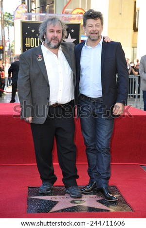 LOS ANGELES, CA - DECEMBER 8, 2014: Director Peter Jackson with actor Andy Serkis (left) on Hollywood Blvd where he was honored with the 2,538th star on the Hollywood Walk of Fame.  - stock photo