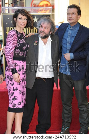 LOS ANGELES, CA - DECEMBER 8, 2014: Director Peter Jackson with Evangeline Lilly & Orlando Bloom on Hollywood Blvd where he was honored with the 2,538th star on the Hollywood Walk of Fame.  - stock photo