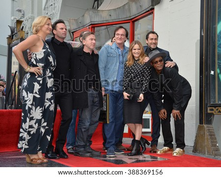 LOS ANGELES, CA - DECEMBER 21, 2015: Director Quentin Tarantino & Zoe Bell, Tim Roth, Quentin Tarantino, Jennifer Jason Leigh, Demian Bichir, Samuel L. Jackson - at Tarantino's Walk of Fame ceremony. - stock photo