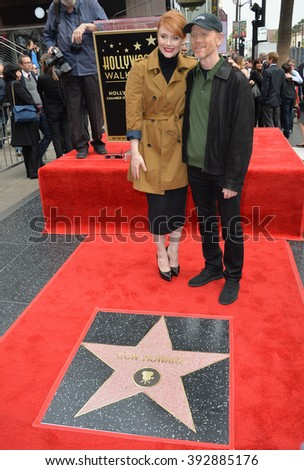 LOS ANGELES, CA - DECEMBER 10, 2015: Director Ron Howard & daughter actress Bryce Dallas Howard at Ron Howard's Hollywood Walk of Fame star ceremony - stock photo