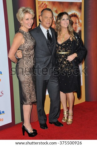 "LOS ANGELES, CA - DECEMBER 9, 2013: Emma Thompson with Tom Hanks & wife Rita Wilson at the US premiere of their movie ""Saving Mr Banks"" at Walt Disney Studios, Burbank.  - stock photo"