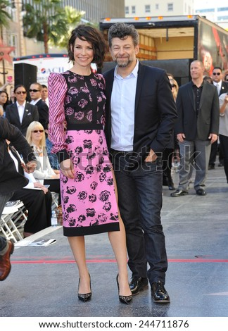 LOS ANGELES, CA - DECEMBER 8, 2014: Evangeline Lilly & Andy Serkis on Hollywood Blvd where director Peter Jackson was honored with the 2,538th star on the Hollywood Walk of Fame.  - stock photo
