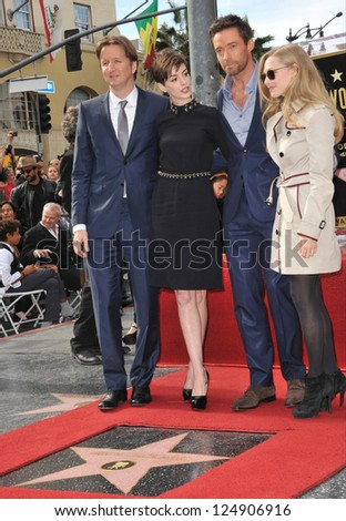 LOS ANGELES, CA - DECEMBER 13, 2012: Hugh Jackman & Les Miserable co-stars Anne Hathaway (left) & Amanda Seyfried & director Tom Hooper (left). Jackman was honored with a star on the Hollywood Blvd. - stock photo