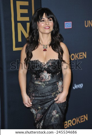 """LOS ANGELES, CA - DECEMBER 15, 2014: Maddalena Ischiale at the Los Angeles premiere of her movie """"Unbroken"""" at the Dolby Theatre, Hollywood.  - stock photo"""