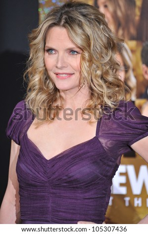 """LOS ANGELES, CA - DECEMBER 5, 2011: Michelle Pfeiffer at the world premiere of her new movie """"New Year's Eve"""" at Grauman's Chinese Theatre, Hollywood. December 5, 2011  Los Angeles, CA - stock photo"""