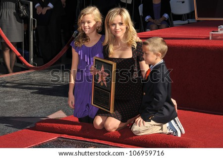 LOS ANGELES, CA - DECEMBER 1, 2010: Reese Witherspoon & children on Hollywood Boulevard where she was honored with the 2,425th star on the Hollywood Walk of Fame. - stock photo