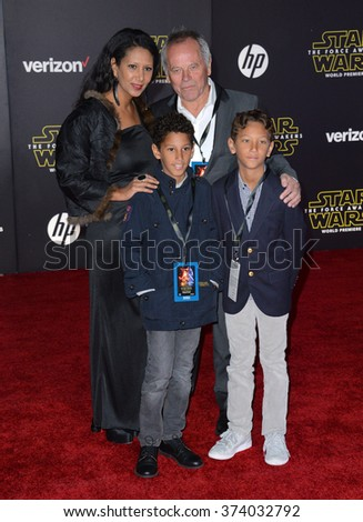 "LOS ANGELES, CA - DECEMBER 14, 2015: Restauranteur Wolfgang Puck & family at the world premiere of ""Star Wars: The Force Awakens"" on Hollywood Boulevard. Picture: Paul Smith / Featureflash - stock photo"