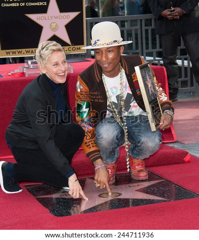LOS ANGELES, CA - DECEMBER 4, 2014: Singer/songwriter Pharrell Williams with Ellen DeGeneres on Hollywood Boulevard where he was honored with the 2,537th star on the Hollywood Walk of Fame.