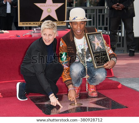 LOS ANGELES, CA - DECEMBER 4, 2014: Singer/songwriter Pharrell Williams with Ellen DeGeneres on Hollywood Boulevard where he was honored with the 2,537th star on the Hollywood Walk of Fame. - stock photo