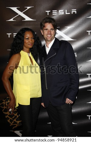 LOS ANGELES, CA - FEB 9: Garcelle Beauvais; Franz von Holzhausen at the Tesla Worldwide Debut of Model X on February 9, 2012 in Hawthorne, Los Angeles, California - stock photo
