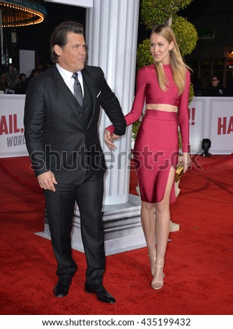 "LOS ANGELES, CA - FEBRUARY 1, 2016: Actor Josh Brolin & fiance' Kathryn Boyd at the world premiere of his movie ""Hail Caesar!"" at the Regency Village Theatre, Westwood."