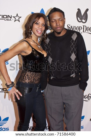 LOS ANGELES, CA - FEBRUARY 19: Actress ERIKA PAGE and Julius attend the Adidas and Snoop Dogg Co-Host ASW Party at The Standard Hotel on February 19, 2011 in Los Angeles, California - stock photo