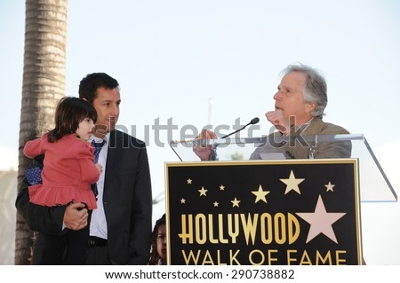 LOS ANGELES, CA - FEBRUARY 1, 2011: Adam Sandler & daughter with Henry Winkler on Hollywood Boulevard where he was honored with the 2,431st star on the Hollywood Walk of Fame. - stock photo
